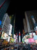 Evening on Times Square NYC. Busy Evening on Times Square New York with dazzling lights and busy crouds Royalty Free Stock Image