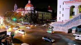 Busy evening Yangon, Myanmar. YANGON, MYANMAR - FEBRUARY 14, 2018: Traffic on the evening Strand Road with a view on administrative buildings of Downtown, on stock video footage