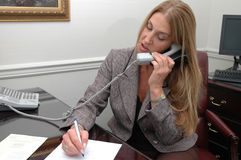 Busy executive. Busy business executive on the phone Royalty Free Stock Photo