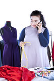 Busy fashion designer speaking on cellphone Royalty Free Stock Photo
