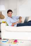 Busy father working at home on laptop Royalty Free Stock Photography
