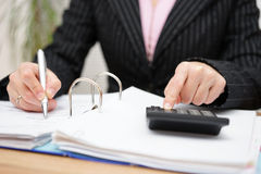 Busy female accountant working with documents Stock Photos