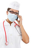 Busy female doctor Stock Images