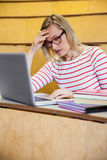 Busy female student working on laptop Royalty Free Stock Photography