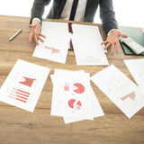 Busy financial adviser working at his business desk with many do Stock Photo