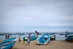 Busy fishermen in the morning along a beach shore Stock Photos