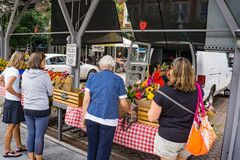 Busy Flower Vendor at the Roanoke City Farmers Market Stock Image