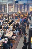 The busy Food Hallen. Amsterdam, Netherlands - 21 November, 2015: View of the food hall at the De Hallen event hall on the Bellamyplein Royalty Free Stock Images
