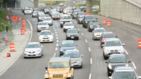Busy Freeway Traffic. Traffic makes it's way around curves on the freeway. Slight blur for copyright issues stock footage