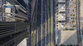 Busy futuristic highway road and modern skyscraper buildings in Dubai city panorama top aerial drone view