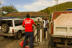 A busy gas station at port elizabeth. Gasoline and diesel being pumped on an island in the grenadines Royalty Free Stock Photos