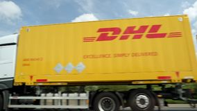Busy German autobahn with DHL truck driving. Bremen, Germany - Circa 2017: Busy German autobahn with DHL delivery truck transporting letters and parcels driving stock video