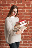 Busy girl student reading while walking Stock Photo