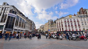 Busy Grand Place intersection and shops in Lille, France Royalty Free Stock Images