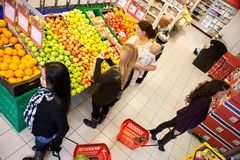 Busy Grocery Store. High angle view of busy people shopping in supermarket Royalty Free Stock Images