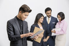 Busy group of business people with their leader. Busy group of business people with businessman leader on foreground Royalty Free Stock Photography