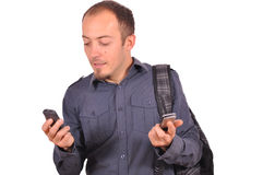 Busy guy with mobile phone Stock Images