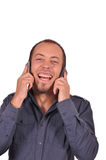 Busy guy with two mobile phones Royalty Free Stock Photo