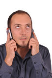 Busy guy with two mobile phones Royalty Free Stock Image