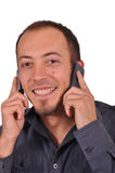 Busy guy with two mobile phones Royalty Free Stock Images