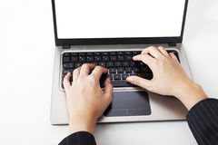 Busy hands typing on laptop Royalty Free Stock Image