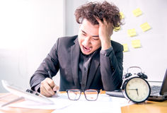 Busy and headache, business office. Busy and headache person, unsuccessful businessman Royalty Free Stock Photography