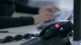 Busy helpdesk telephone stock video footage