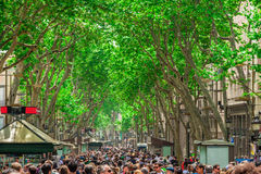 The busy high street of La Rambla in Barcelona. Royalty Free Stock Images