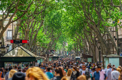 The busy high street of La Rambla in Barcelona. Royalty Free Stock Photo