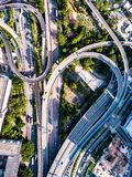 Junction from above. Busy high way junction from above surrounded by green trees Stock Images