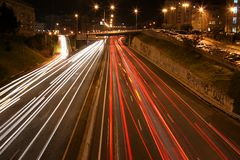 Busy highway. Overview of a highway at night with multiple light streaks Royalty Free Stock Images