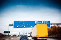 Busy highway autobahn road traffic in Germany. Tilt shift lens used to accent motorway and to emphasize the speed vision royalty free stock photos