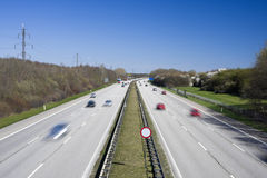 Busy highway with many cars. Motion blur. Royalty Free Stock Images