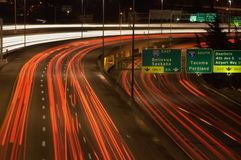 Busy Highway at Night. Streaks of lights from passing cars form interesting patterns in this night exposure of traffic on a busy highway in downtown Seattle royalty free stock photos