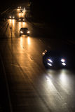 Busy highway at night with cars Stock Photos