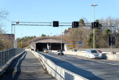 Busy Highway Tunnel. A highway tunnel with cars speeding out of it. Nydalen, Oslo, Norway Stock Image