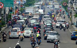 Busy hour in Asia Afrika Street, in Bandung. Indonesia. With many motorcycles and cars in the road Royalty Free Stock Images