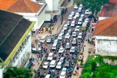 Busy hour in Asia Afrika Street. In Bandung, Indonesia. With many motorcycles and cars in the road, seen from top, tilt shift Stock Images