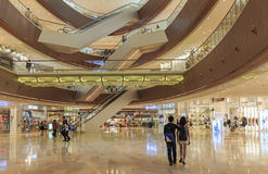 people in busy shopping mall, interior of shopping mall, inside modern shopping center hall Stock Photo
