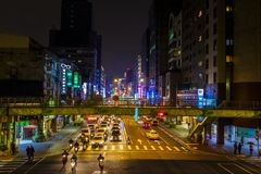Busy intersection in Taipei at night. Traffic at a busy intersection in downtown Taipei, Taiwan, at night Stock Image