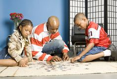 Busy with a jigsaw Stock Image