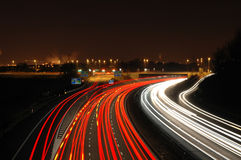 Busy Junction. Traffic speeds past a motorway junction at night Stock Image