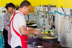 Busy kitchen of Thai restaurant. KOH KHO KHAO, THAILAND - NOV 10: An unidentified Thai cook at work in local restaurant and making great local food in Phang Nga Stock Photos