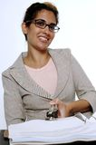 Busy Lady. A young woman notary happy while she works Royalty Free Stock Photography