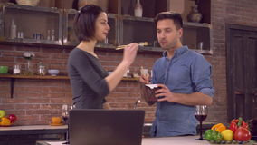 Busy lady and guy eat delivery food stock video footage