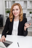 Busy lady in office Stock Photo