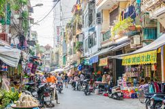 Busy local daily life of the morning street market in Hanoi, Vietnam. A busy crowd of sellers and buyers in the market. Hanoi,Vietnam - October 31,2017 : Busy Royalty Free Stock Photography
