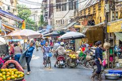 Busy local daily life of the morning street market in Hanoi, Vietnam. A busy crowd of sellers and buyers in the market. Hanoi,Vietnam - October 31,2017 : Busy Royalty Free Stock Image