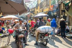 Busy local daily life of the morning street market in Hanoi, Vietnam. A busy crowd of sellers and buyers in the market. Hanoi,Vietnam - November 2,2017 : Busy Stock Photos