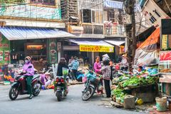 Busy local daily life of the morning street market in Hanoi, Vietnam. A busy crowd of sellers and buyers in the market. Hanoi,Vietnam - November 1,2017 : Busy Royalty Free Stock Photos